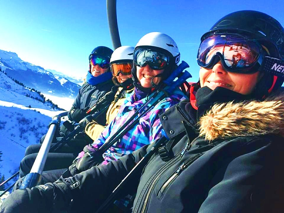 This group of skiers are on the ski lift and are ready for a day of fun, skiing is one of the main things to do in Morzine.