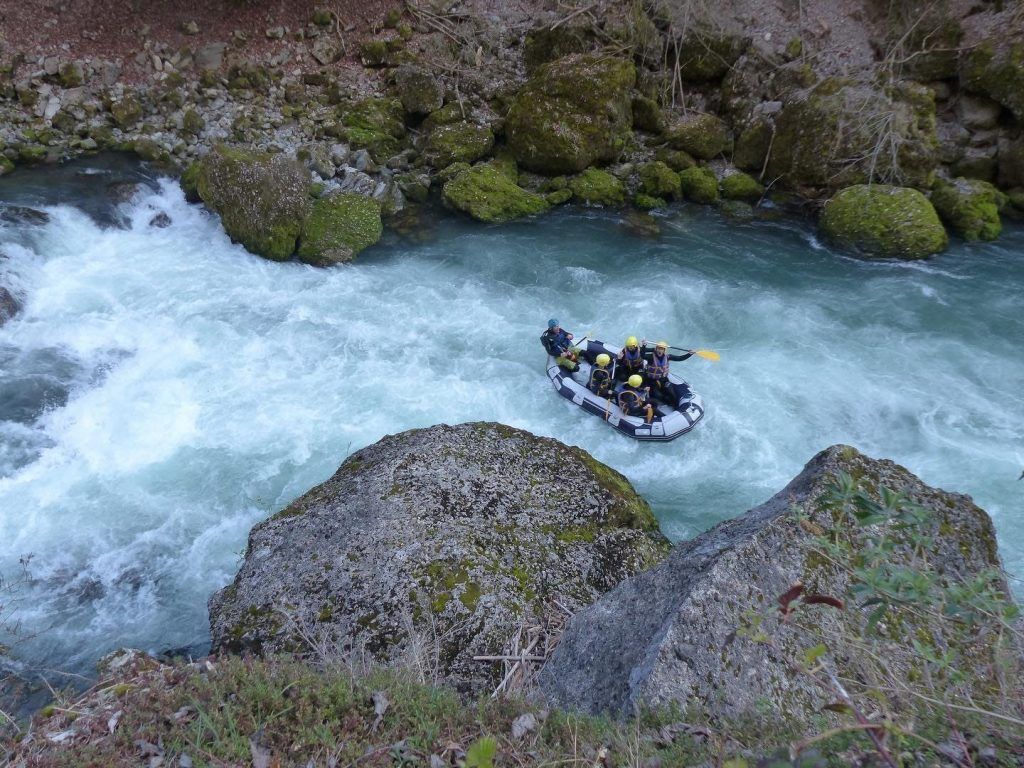 A group of rafters going through rapids.