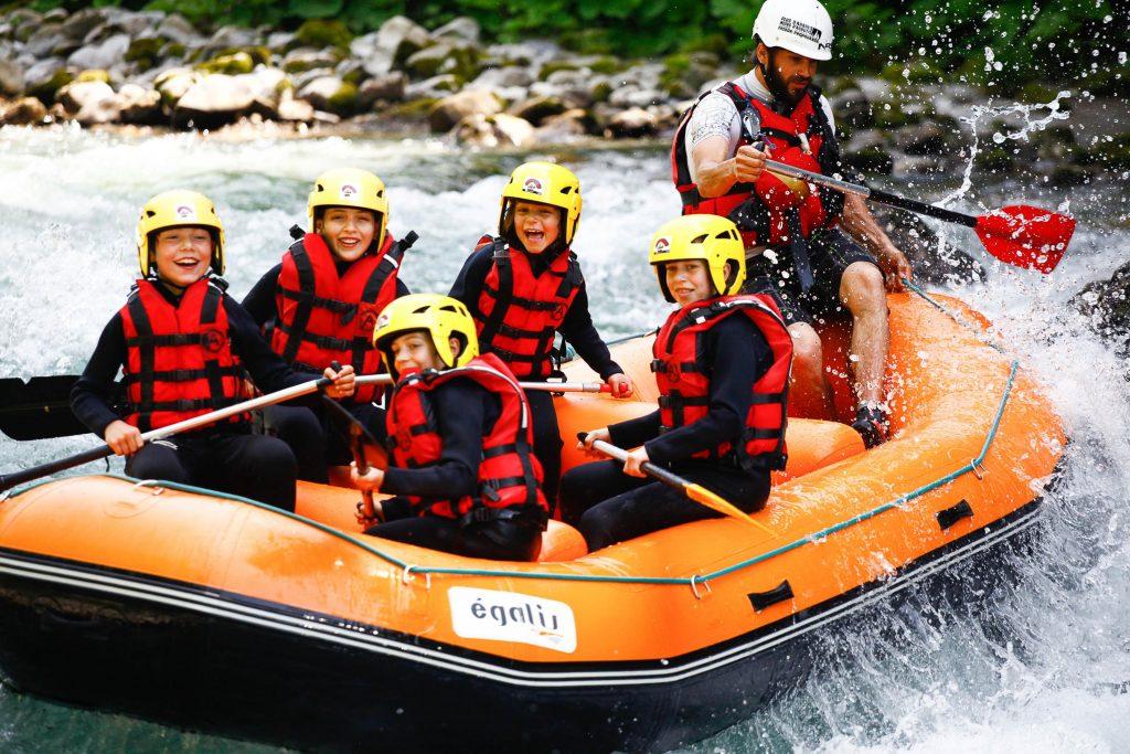 Children are having fun on their rafting tour.