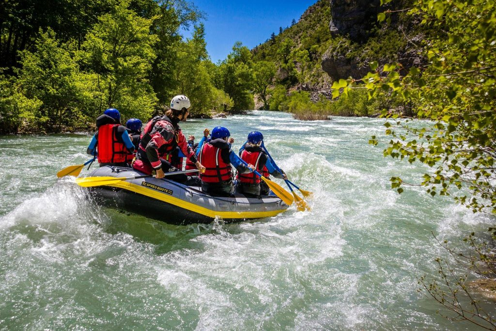 A group and their guide are enjoying a nice ride on the river.