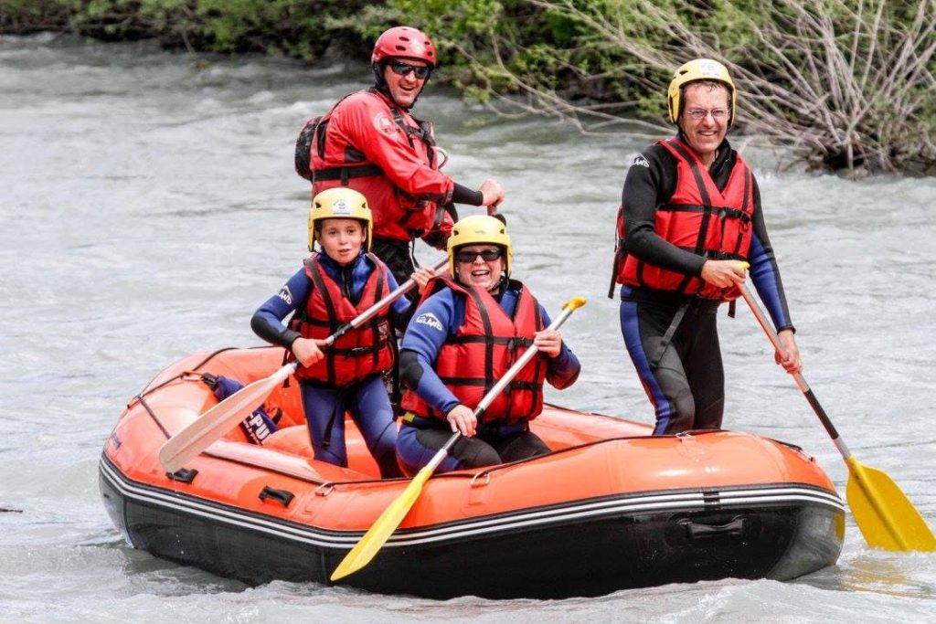 A happy family is enjoying their rafting tour.