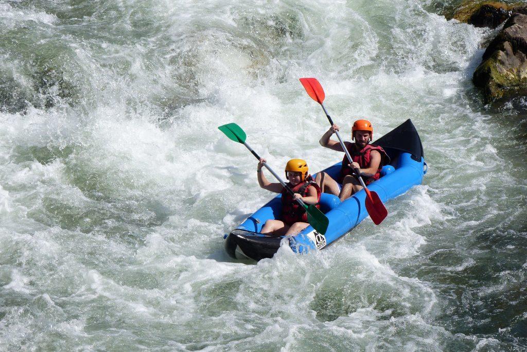2 people on a canoe raft.