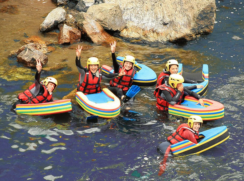 A group of women are enjoying their first hydrospeed experience.