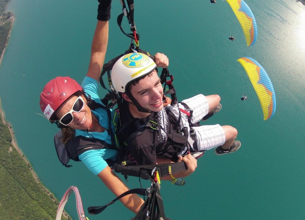 A young man on his first paragliding flight.