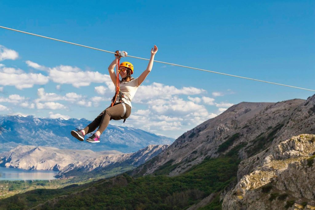A zipline tour participant enjoys the speed and the scenery.