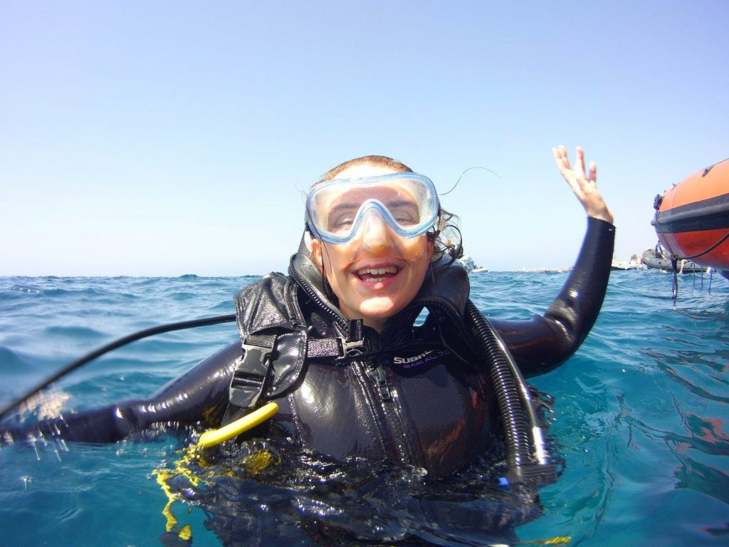 A girl is having fun while scuba diving on the Canary Islands.