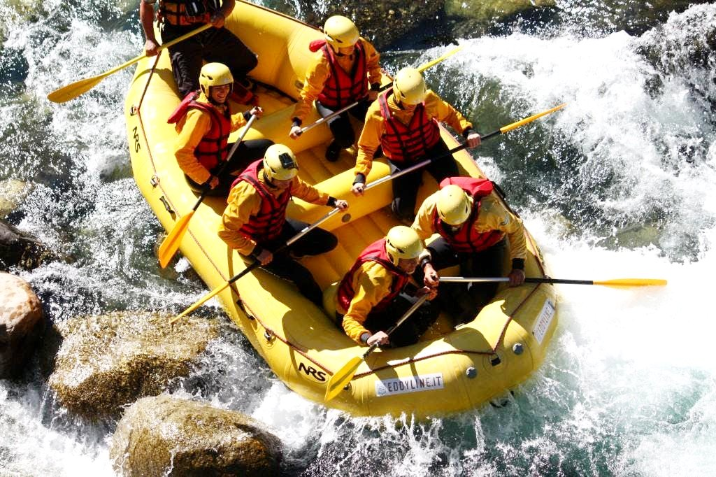 A guide leading his group through strong rapids.