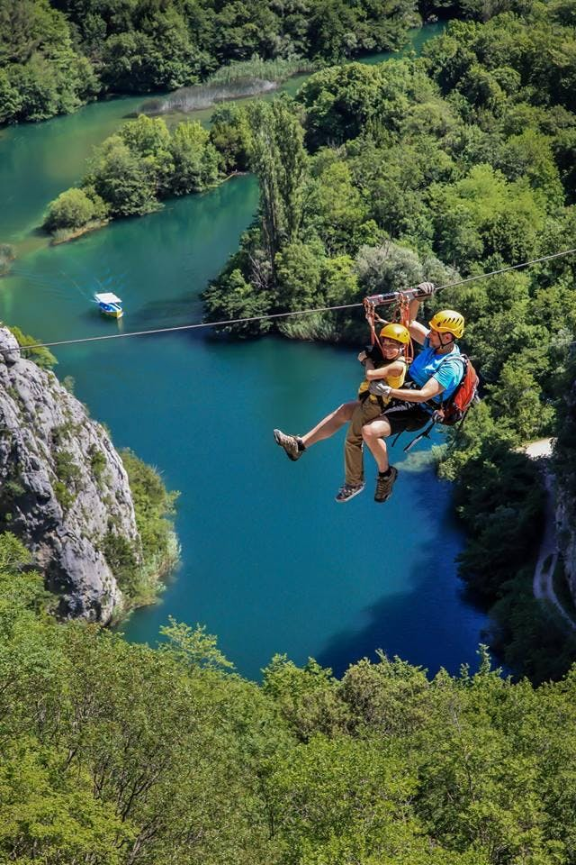 Dad and child on a zipline in Omiš.