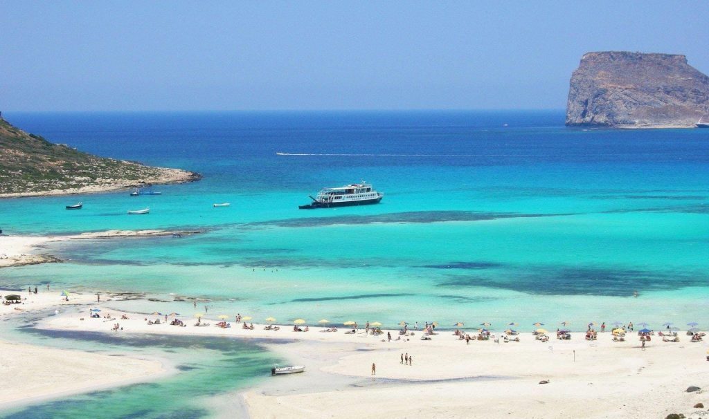 The ship is about to dock on Balos beach during a snorkel boat trip in Crete.