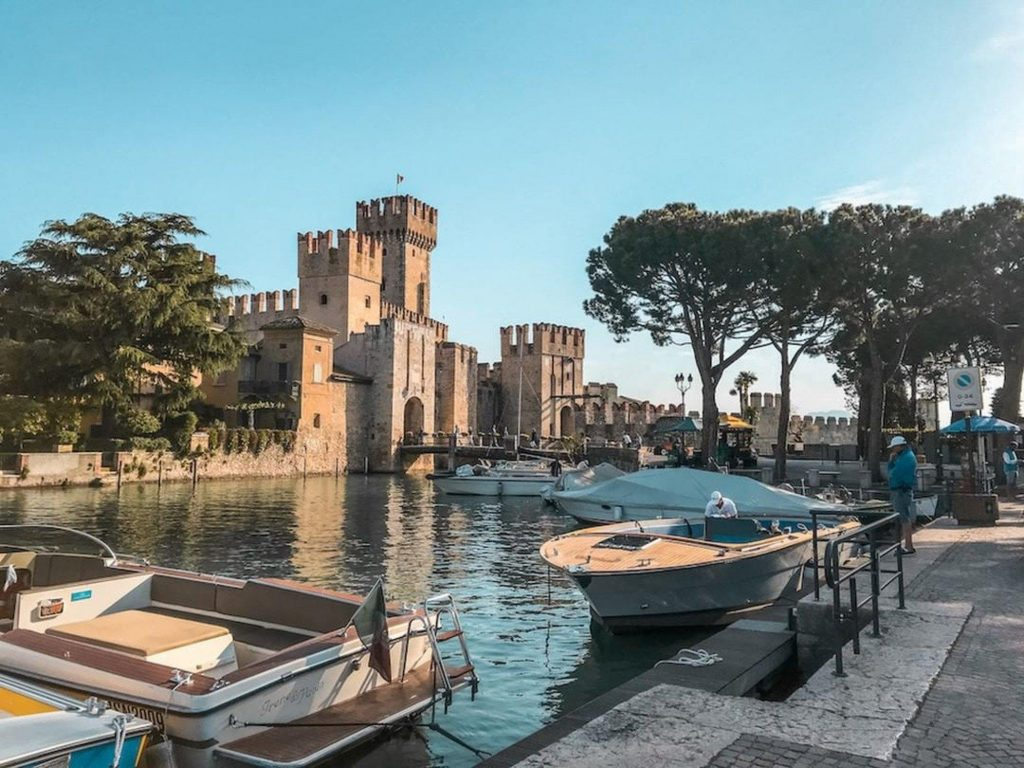 View of one of the castles of Lake Garda during a boat trip on Lake Garda.