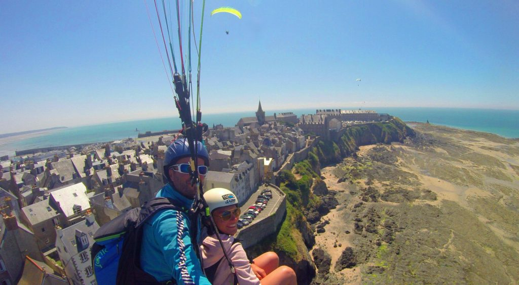 While paragliding in Normandy, you can fly over the charming city of Granville.
