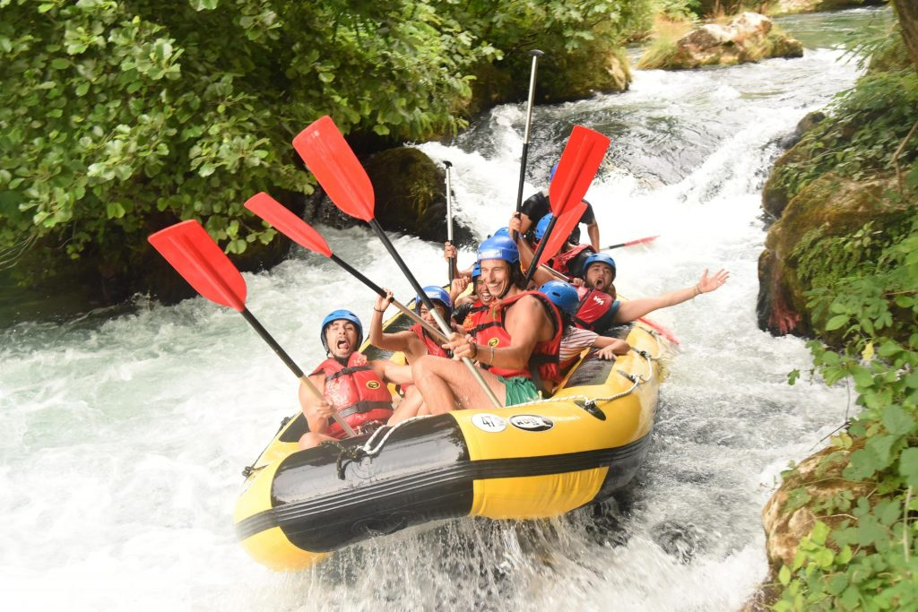 A group iis trying rafting in Croatia on the Cetina river.