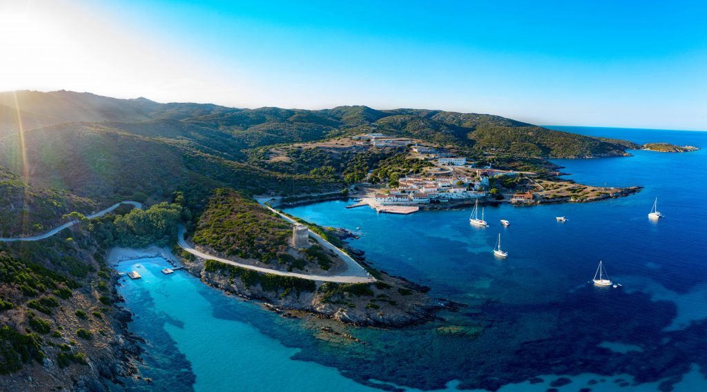 A panoramic view of some of the coves in the Asinara National Park where you can go on one of the most beautiful snorkeling excursions in Sardinia.