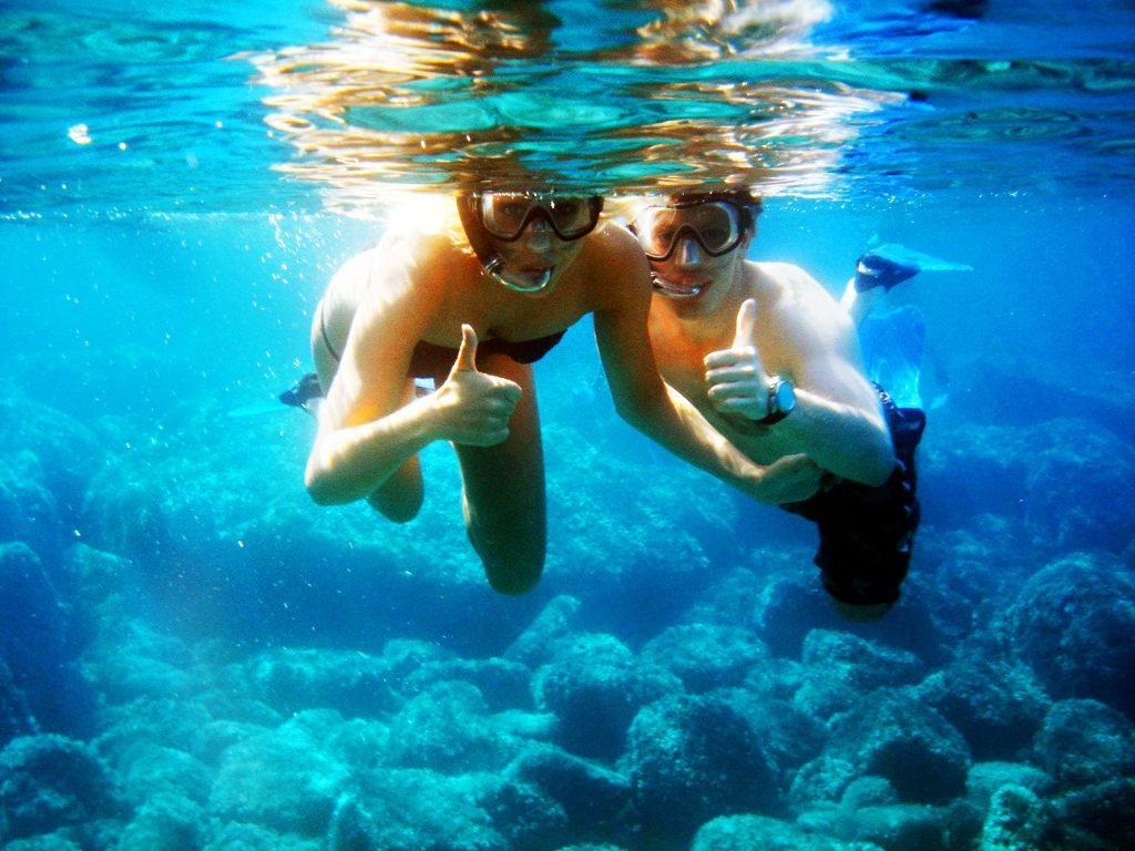 Two people enjoy snorkelling in Alghero.