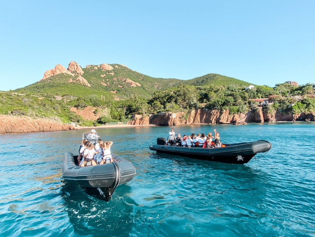 Two boats take tourists on a snorkelling excursion to Îles de Lérins.
