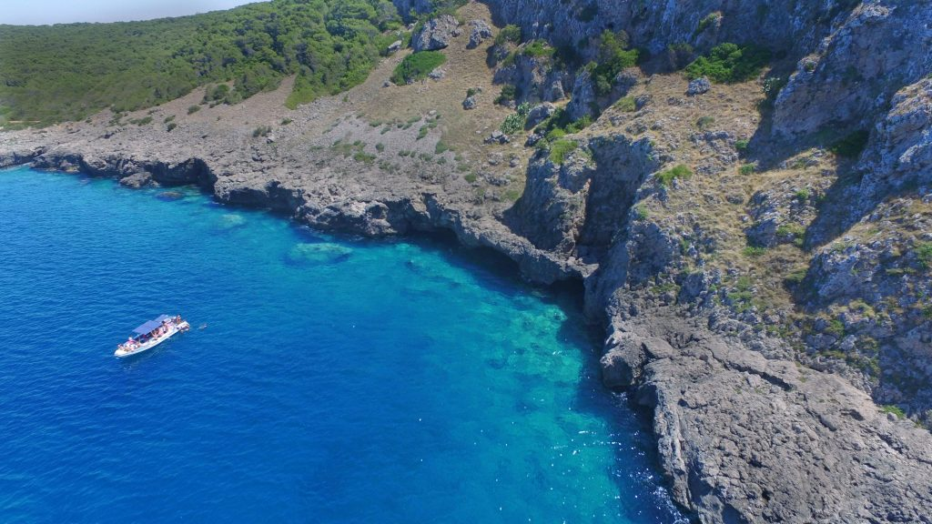 A view from above of a boat trip with snorkelling in Porto Selvaggio.