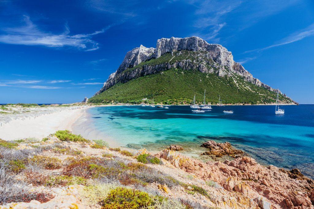 A panoramic view of a beach at Tavolara, a good snorkeling spot in Sardinia.