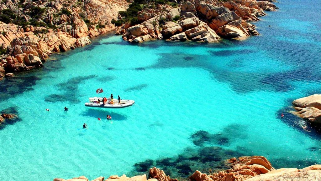 A view from the top of a snorkeling excursion in Cala Coticcio.