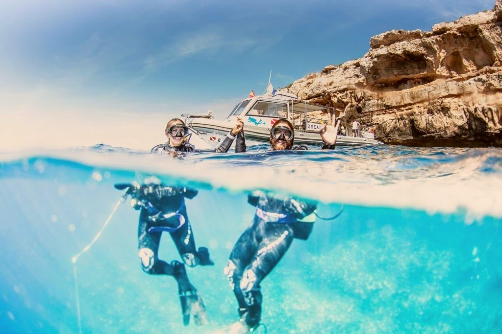 A couple celebrating their first time scuba diving in Spain.