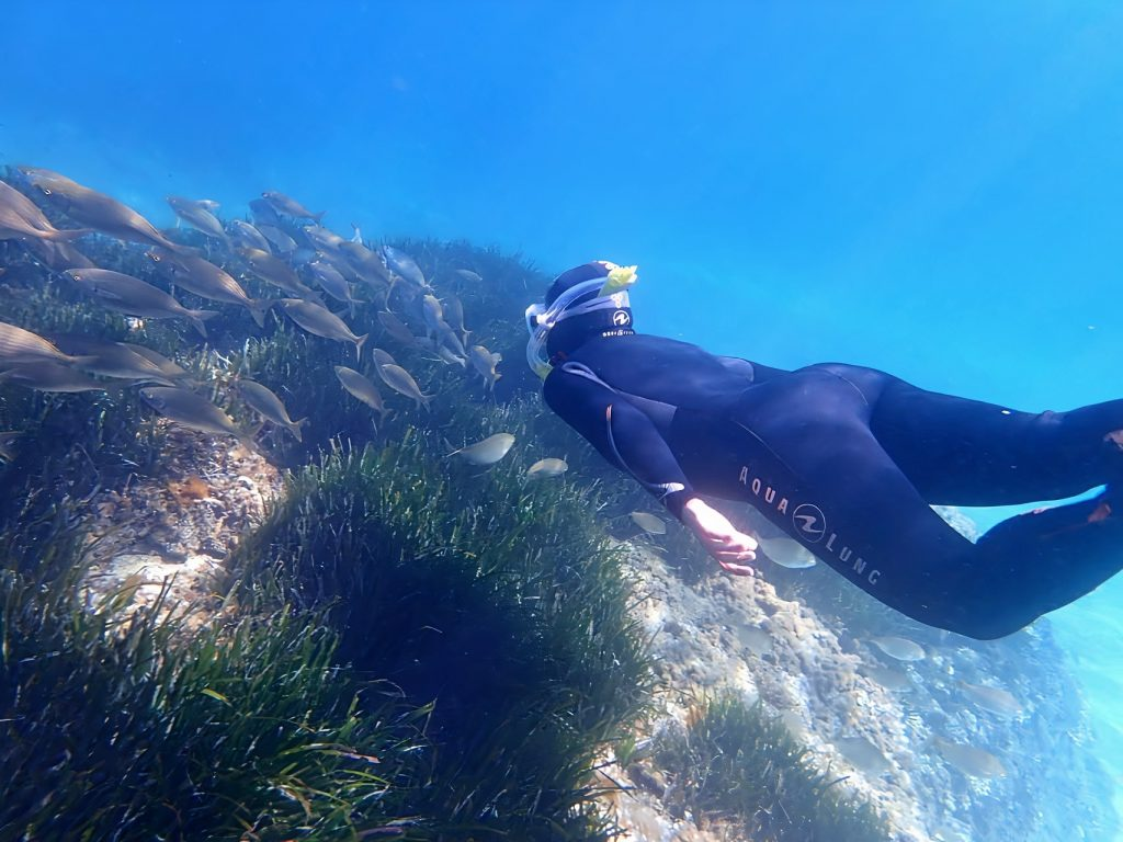 A boy has fun during a snorkeling trip in Cala Delta.