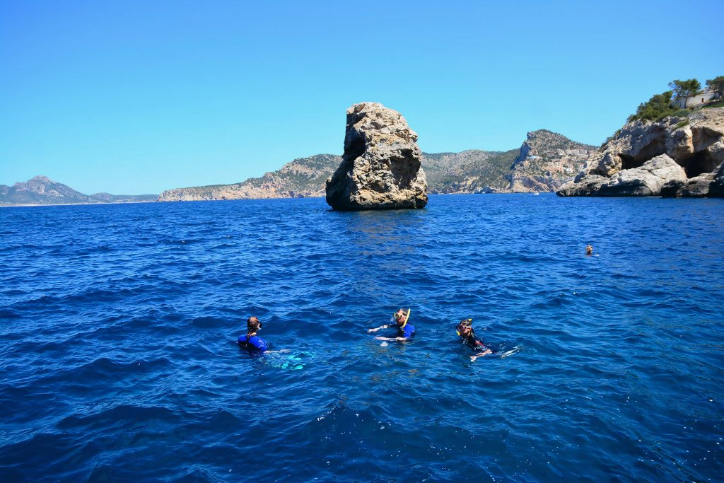 A group of people go on a snorkeling trip near Port D'Andratx.