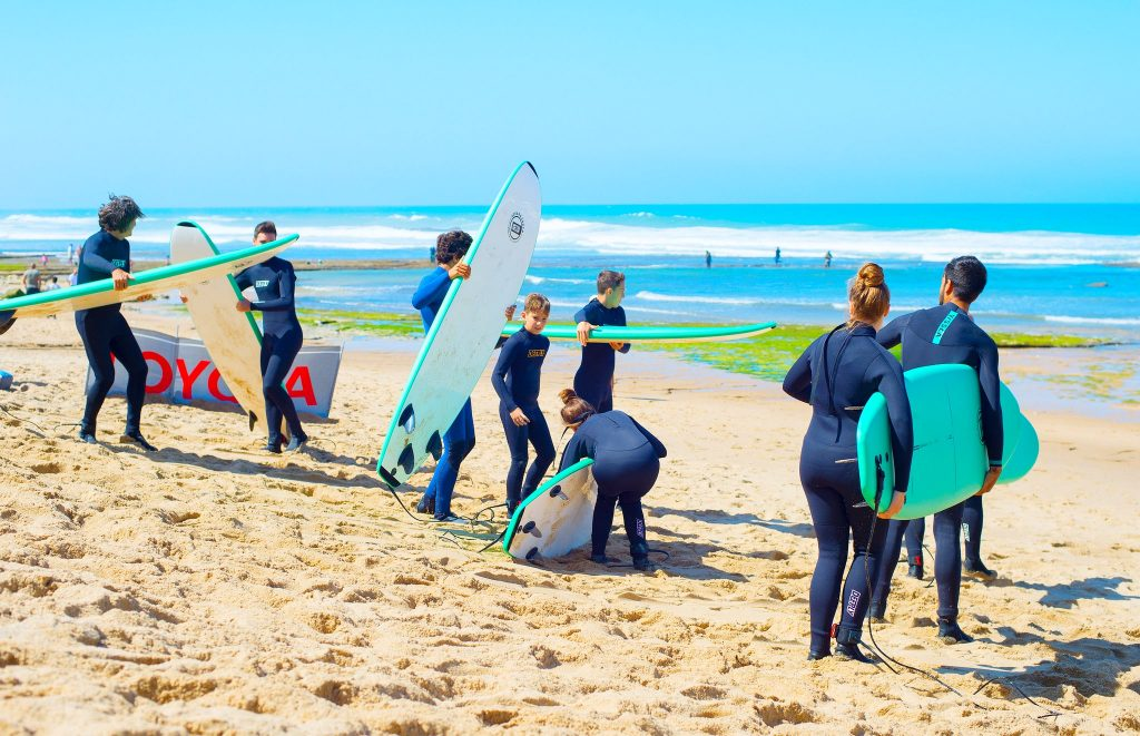 A group is getting ready to go surfing in Portugal.