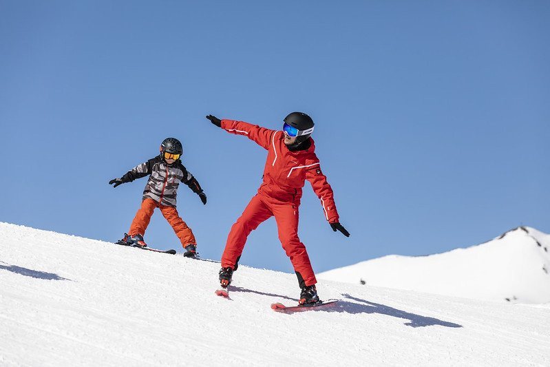 A kid is learning how to ski in Catalonia, in Spain.