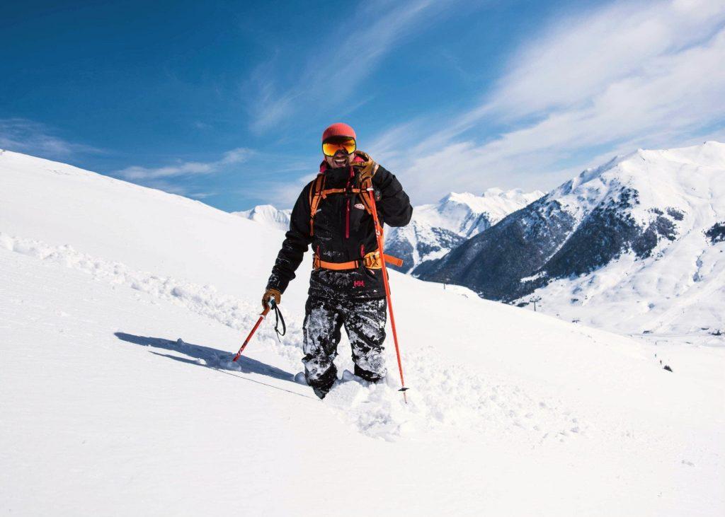 An off-piste skier is exploring the beautiful ski resorts in Spain.
