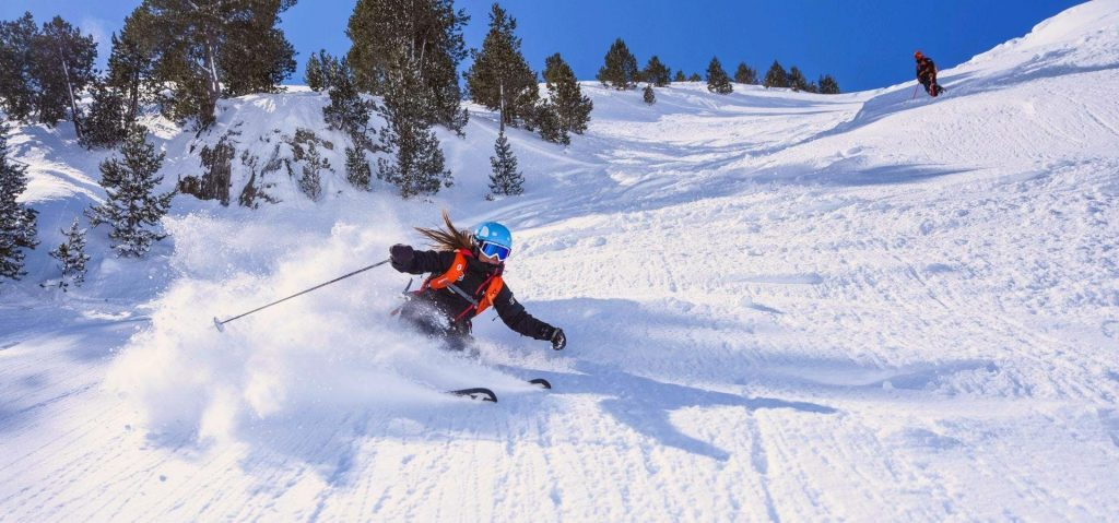 A woman is enjoying the empty slopes of Sierra Nevada, Europe's most southern ski resort and a great spot for skiing in Spain.